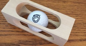 Golf Ball in a Block of Wood