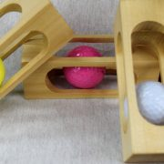 Mystery Golf Ball in a Block of Wood